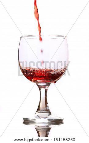 Red wine pouring down into a wine glass