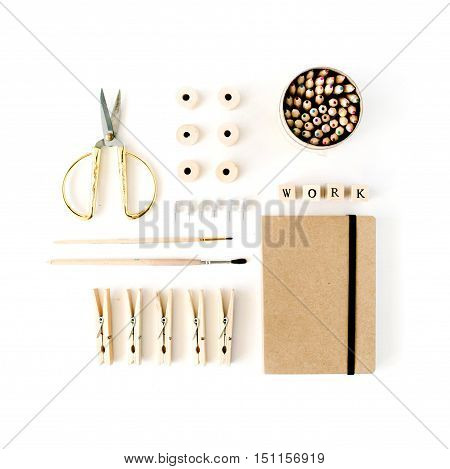 Flat lay top view brown eco style office table desk. feminine working supplies: craft diary pencil box brushes golden scissors spools pins