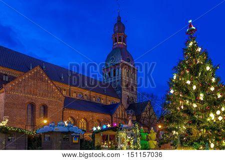 Glowing Christmas Tree At Market Near Riga Cathedral