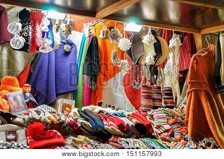 Stall With Colorful Woolen Clothes At The Riga Christmas Market