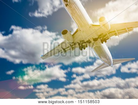 Jet Airplane Landing with Dramatic Clouds and Sky Behind.