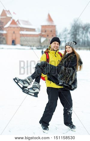 Young Girl And Fellow At Rink In Winter Trakai