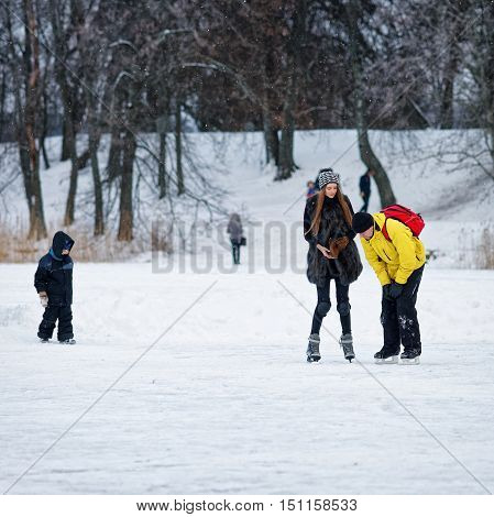 Young Girl And Fellow At The Rink In Trakai