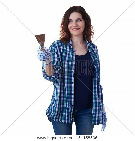 Smiling young woman in casual clothes over white isolated background holding putty knife, happy people and construction concept