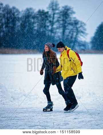 Young Girl And Fellow Ice Skating In Trakai Of Lithuania