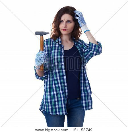 Young woman in casual clothes over white isolated background holding hammer, happy people and construction concept