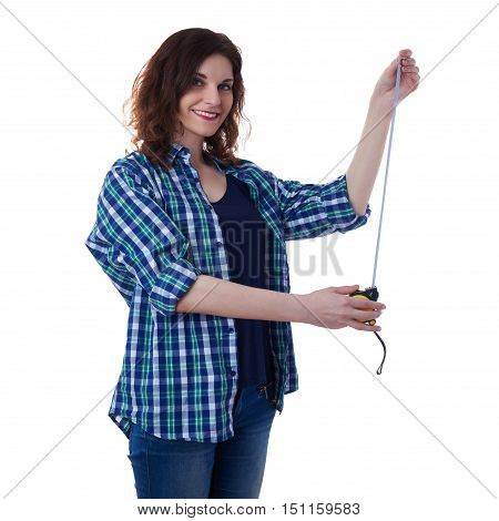 Smiling young woman in casual clothes over white isolated background holding measuring tape, happy people and construction concept