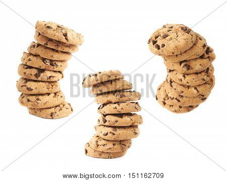 Twisted stack round cookies with the pieces of chocolate isolated over the white background
