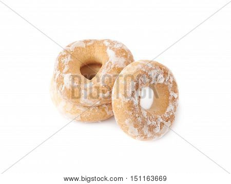 Stack of sushki round small dried cakes with hole with sugar powder isolated over the white background