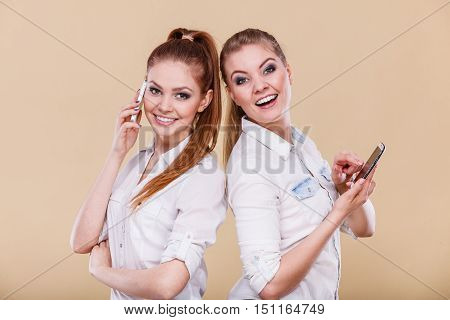 Girls Using Mobile Phones Talking Reading Message