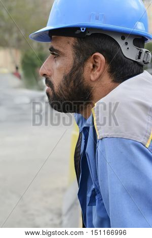 Tehran IRAN - June 6 2016 A portrait of Workman at Building Site