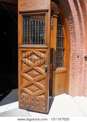beautiful old ornate wood doors found on the campus of Flagler College in St. Augustine Florida. The style of the building is Spanish Renaissance.