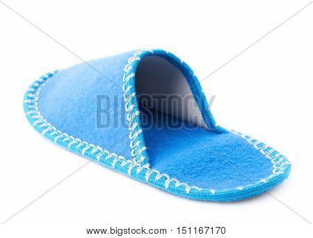 Single blue house slipper isolated over white background