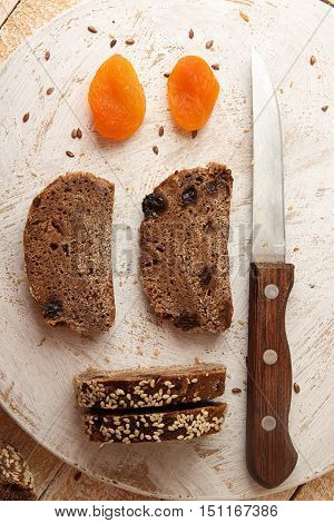 Slices Of Rye  Bread Over On White Round Wooden Board