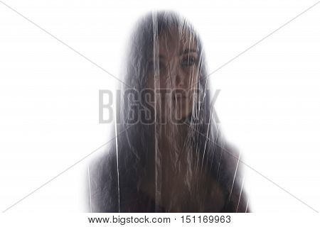 Young Brunette Woman Covering Herself With A Plastic.