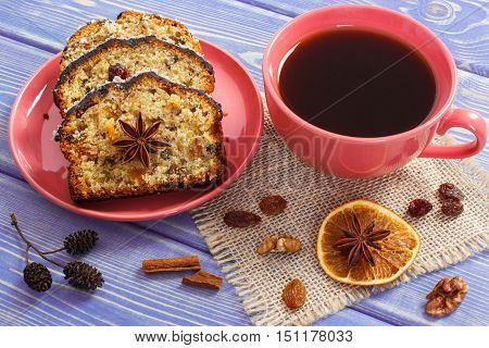 Cup Of Coffee And Fresh Fruitcake With Ingredients On Boards