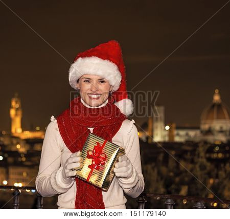 Smiling Woman At Piazzale Michelangelo With Christmas Present Box