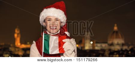 Woman In Christmas Hat At Piazzale Michelangelo Showing Flag