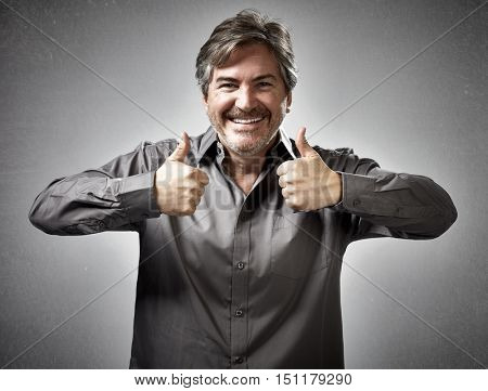 Happy man with thumbs.