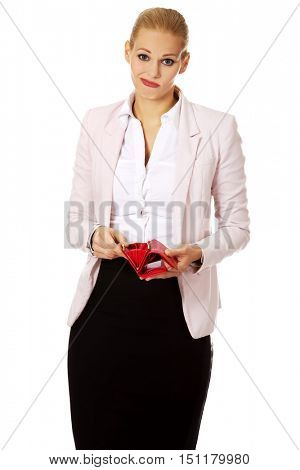 Worried business woman shows her empty wallet