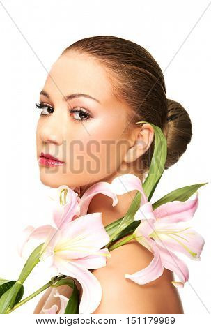 Beautiful spa woman with lily.