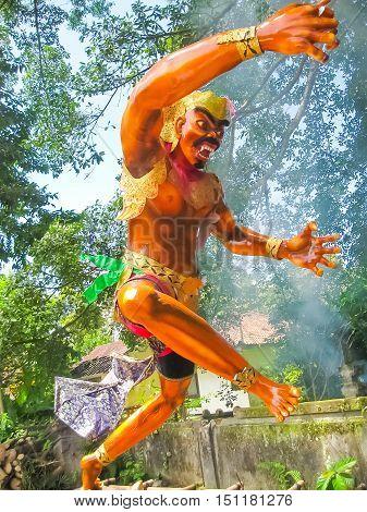 Balinese monster Ogoh-Ogoh on green trees background