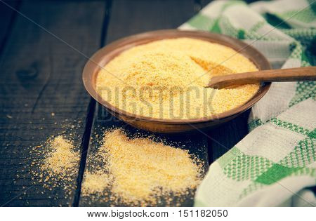 Yellow Corn Flour In A Ceramic Bowl On A Rustic Wooden Table. Ingredients For Preparation Of A Itali
