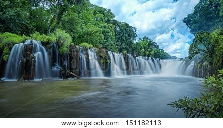 Mountain with waterfall cascades in Laos .