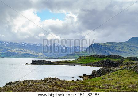 View of fjord and rain clouds in the north Iceland