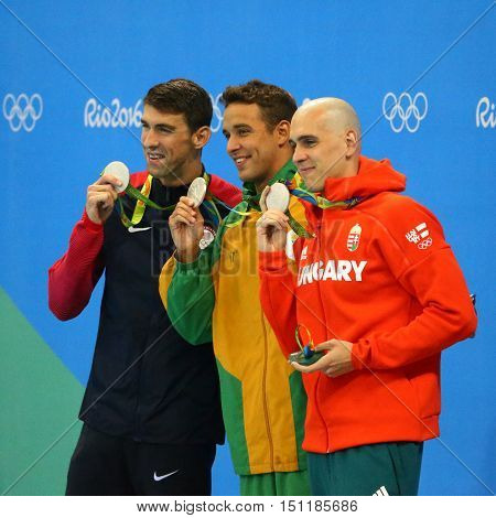 RIO DE JANEIRO, BRAZIL - AUGUST 12, 2016: Silver medalists Michael Phelps USA (L), Laszlo Cseh HUN and Chad le Clos RSA during medal ceremony after Men's 100m butterfly of the Rio 2016 Olympics