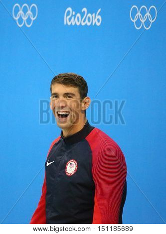 RIO DE JANEIRO, BRAZIL - AUGUST 12, 2016: Michael Phelps of United States during medal ceremony after Men's 100m butterfly of the Rio 2016 Olympics at the Olympic Aquatics Stadium