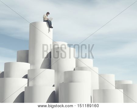 Man sitting on top of cylinders using a laptop. This is a 3d render illustration