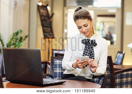 Picture of young businesswoman working cafe