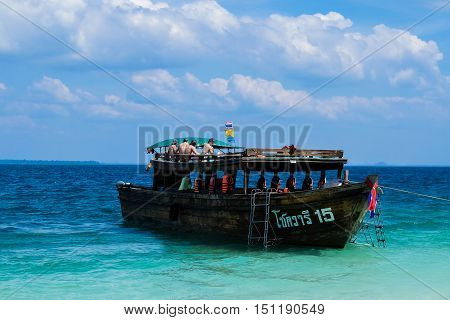 KRABI - JANUARY 19, 2015 : People on the boat to Railay Beach in Krabi, Thailand on a sunny day JANUARY 20, 2015. Railay Beach is a small peninsula with white sand beaches, soaring limestone cliffs, viewpoints, caves and a lagoon hidden inside the cliffs,