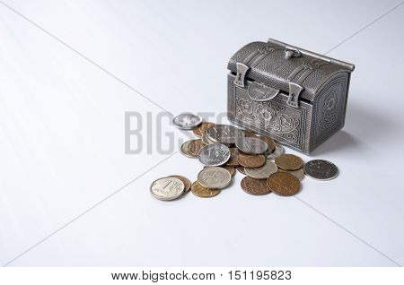 Still life: decorative iron chest and small coins