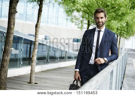 Confident city man in smart suit in town