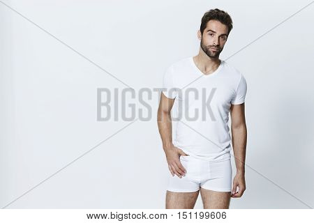 Man wearing white t-shirt and underpants studio