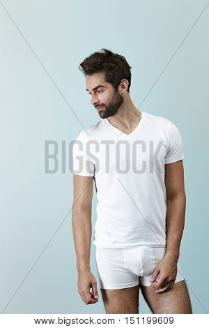 Man in underwear posing in studio looking away