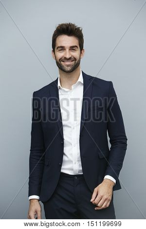 Smiling guy in sharp suit portrait -buisness