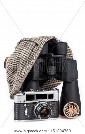Black binoculars, Sherlock Holmes hat and Camera Isolated on White Background
