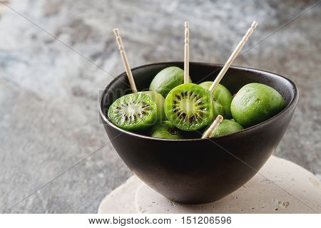 New Zealand Exotic Food. Berry Nergi, Or Small Kiwi. In A Brown