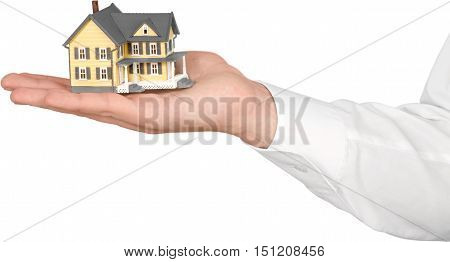 Men's Hand Holding a Model of a House - Isolated