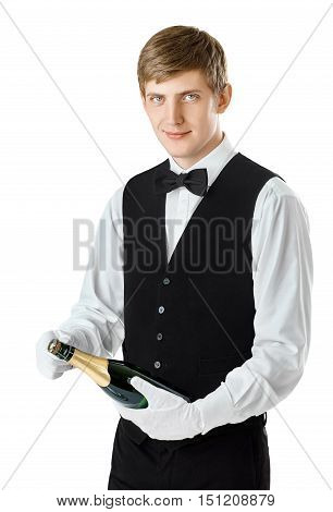 Young Handsome Waiter Opening Bottle Of Champagne