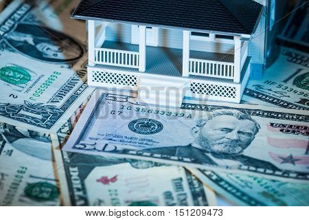 Model of a House on Money - Close Up