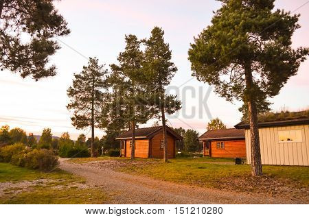 wooden cottages at a campground in norway