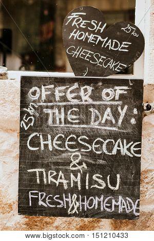 Offer on the blackboard written in chalk