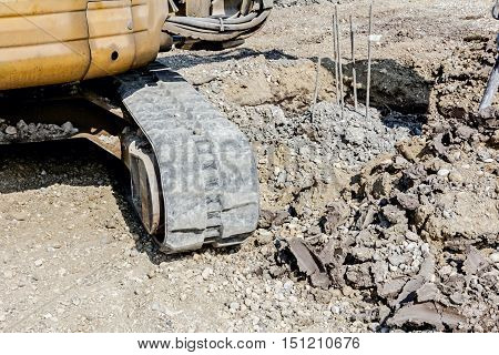 Close up view on crawler during moving trough construction site