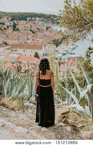 Women tourist looking at City of Hvar