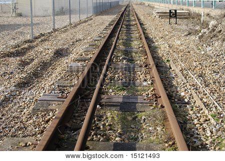 Railway Line On Brighton Beach. UK