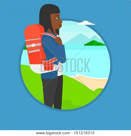 An african young woman with backpack standing on the top of mountain and enjoying the view while looking at landscape of mountains. Vector flat design illustration in the circle isolated on background